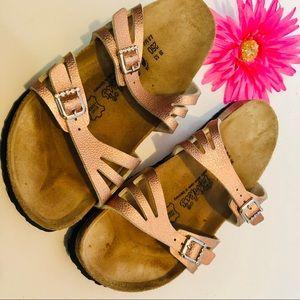 BIRKI'S by Birkenstock's golden pink sandal slides